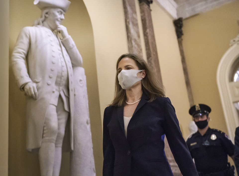Photo -  Judge Amy Coney Barrett, President Donald Trump's nominee for the Supreme Court, arrives for closed meetings with senators, at the Capitol in Washington, Wednesday, Oct. 21, 2020. (AP Photo/J. Scott Applewhite)
