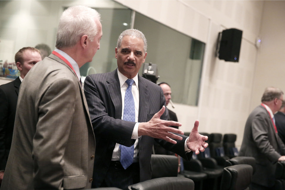 Photo - U.S. Attorney General Eric Holder, center, chats with European Union Counter-Terrorism Coordinator Gilles de Kerchove, left, during EU-US Justice and Home Affairs Ministerial Meeting in Athens, on Wednesday, June 25, 2014. (AP Photo/Petros Giannakouris)