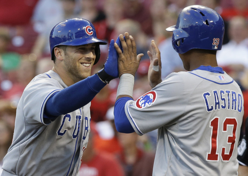 Photo - Chicago Cubs' Mike Olt is congratulated by Starlin Castro (13) after Olt hit a solo home run off Cincinnati Reds starting pitcher David Holmberg in the third inning of a baseball game, Tuesday, July 8, 2014, in Cincinnati. (AP Photo/Al Behrman)