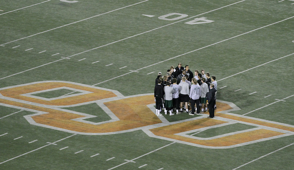 Photo - Members of the Norman North football team have a pre-game meeting during the Class 6A Oklahoma state championship football game between Norman North High School and Jenks High School at Boone Pickens Stadium on Friday, Nov. 30, 2012, in Stillwater, Okla.   Photo by Chris Landsberger, The Oklahoman
