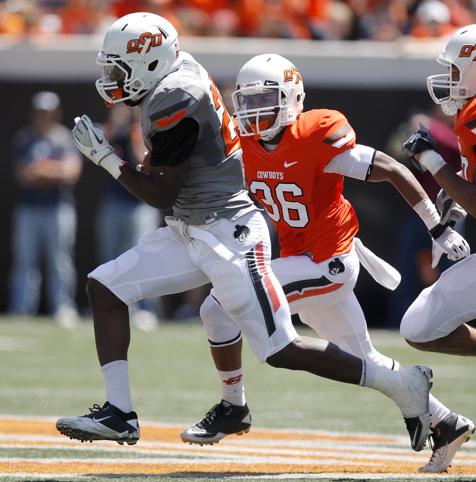 Photo - OSU's Desmond Roland runs past Jonovan Griffin during Oklahoma State's spring football game at Boone Pickens Stadium in Stillwater, Okla., Saturday, April 21, 2012. Photo by Bryan Terry, The Oklahoman