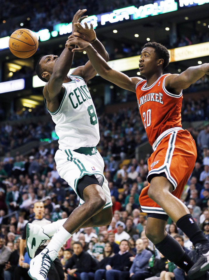 Milwaukee Bucks' Doron Lamb (20) fouls Boston Celtics' Jeff Green (8) during the first quarter of an NBA basketball game in Boston, Friday, Dec. 21, 2012. (AP Photo/Michael Dwyer)