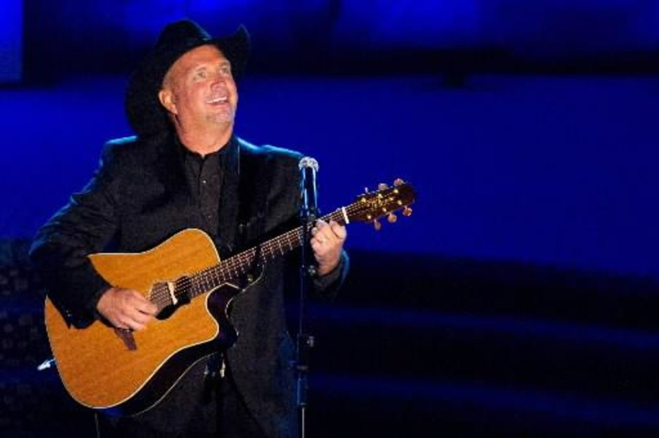 Photo - Inductee Garth Brooks performs onstage at the 42nd Annual Songwriters Hall of Fame Awards in New York, Thursday, June 16, 2011. (AP Photo/Charles Sykes)