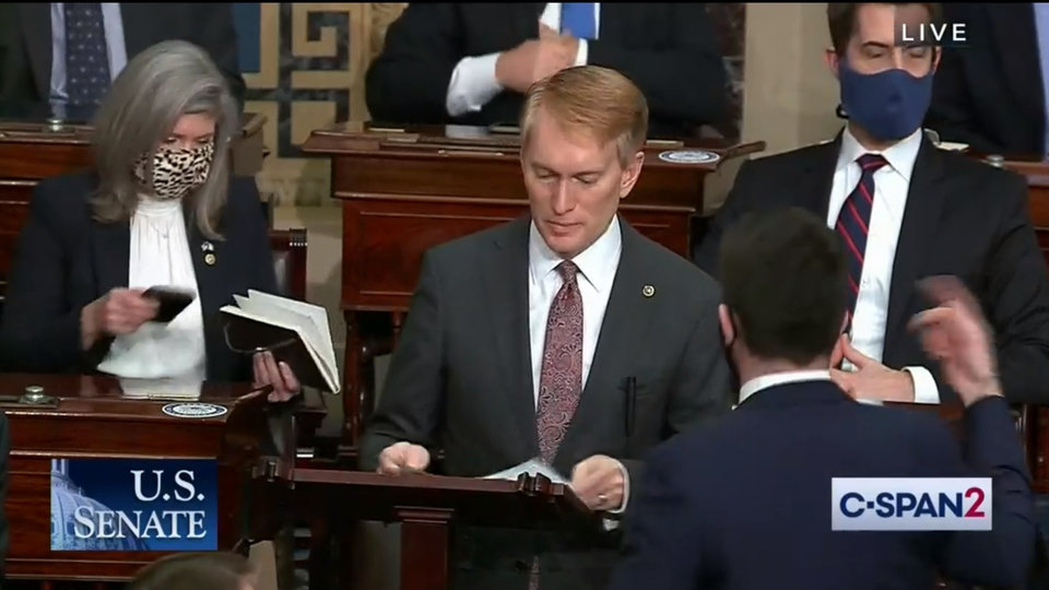 Photo -  This screen grab from C-SPAN2 shows the moment before Sen. James Lankford, R-Oklahoma City, was told that protesters had breached the Capitol. Lankford had been addressing the Senate during debate over objections to Arizona's Electoral College results.