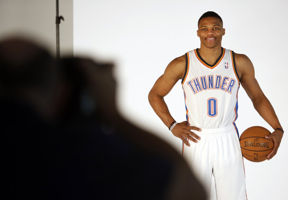 Russell Westbrook poses for photos during media day with the Oklahoma City Thunder in Oklahoma City, Thursday September  27, 2013. Photo By Steve Gooch, The Oklahoman