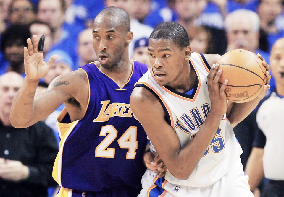 Photo - Lakers guard Kobe Bryant, left, isn't the same player he once was.  PHOTO BY NATE BILLINGS, THE OKLAHOMAN