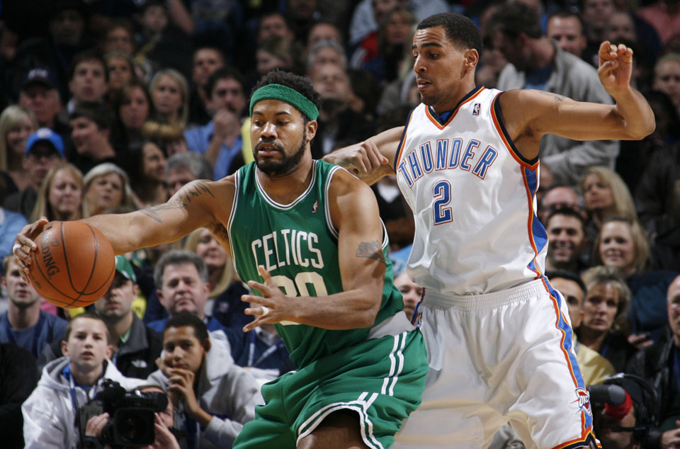 Photo - Boston's Rasheed Wallace (30) tries to get around Thabo Sefolosha (2) of Oklahoma City in the first half of the NBA basketball game between the Boston Celtics and the Oklahoma City Thunder at the Ford Center in Oklahoma City, Friday, Dec. 4, 2009. Photo by Nate Billings, The Oklahoman ORG XMIT: KOD