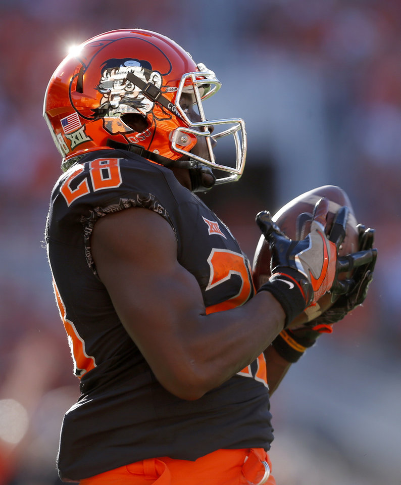 Photo - Oklahoma State's James Washington (28) catches a touchdown pass in the third quarter during a college football game between the Oklahoma State University Cowboys (OSU) and the Iowa State University at Boone Pickens Stadium in Stillwater, Okla., Saturday, Oct. 8, 2016. Photo by Sarah Phipps, The Oklahoman
