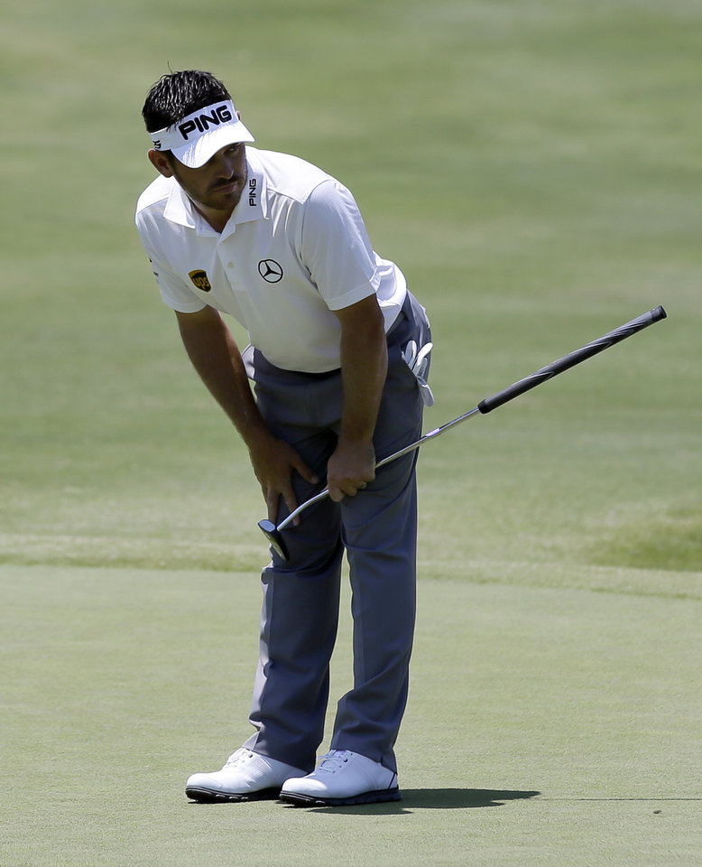 Photo - Louis Oosthuizen of South Africa leans over as he watches his birdie attempt stop wide of the cup on the second green during the final round of the Byron Nelson Championship golf tournament, Sunday, May 18, 2014, in Irving, Texas. (AP Photo/Tony Gutierrez)