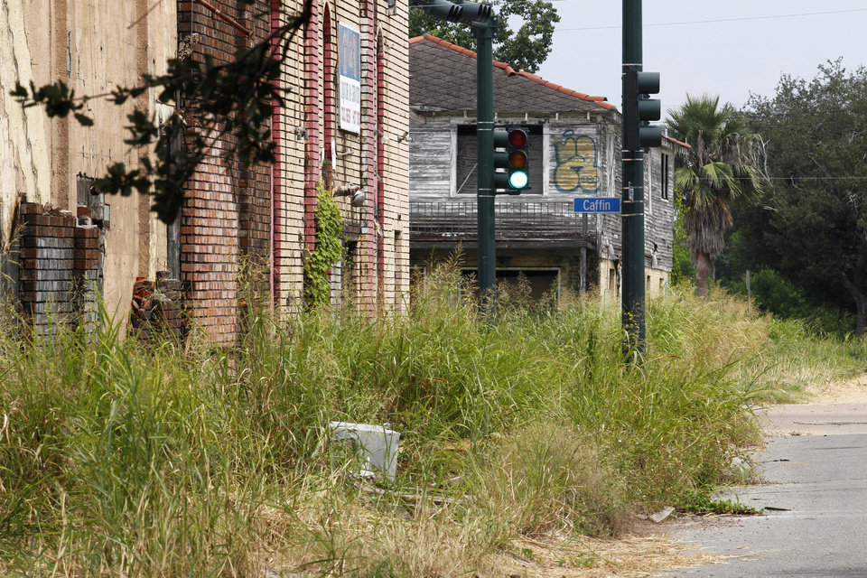 FILE PHOTO - In this Aug. 25, 2011 file photo, destroyed buildings and overgrown weeds are seen from Flood St. looking towards Caffin St. in the Lower 9th Ward section of New Orleans. Residents and the City of New Orleans may be pushing back against tour companies ushering out-of-towners into to the Lower 9th Ward, the neighborhood made famous when floodwalls and levees failed in 2005, pushing homes off their foundations and stranding residents on rooftops. (AP Photo/Gerald Herbert, file)
