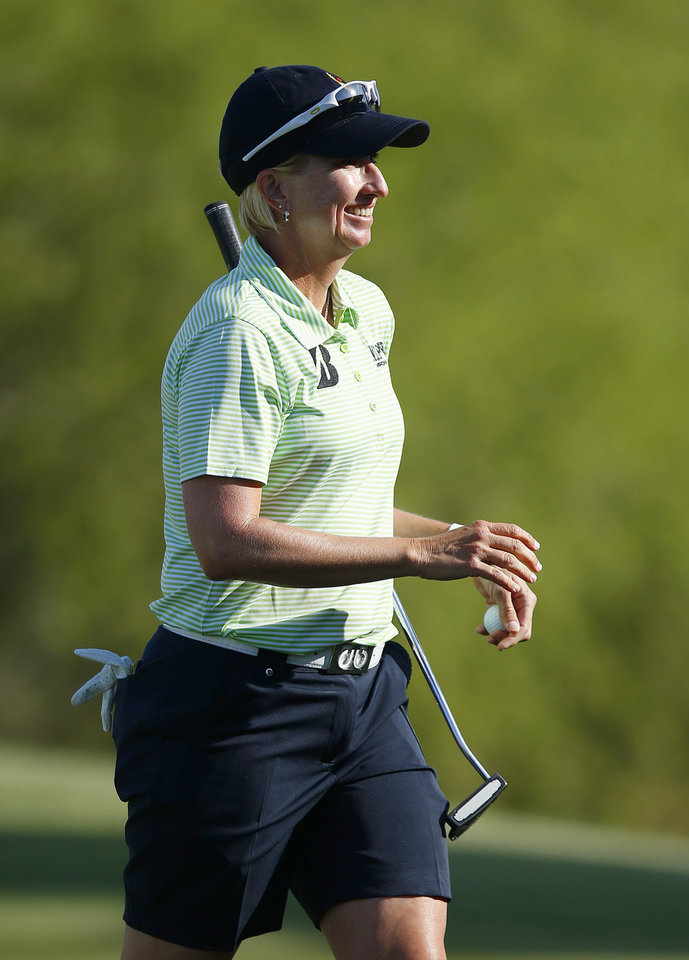 Photo - Karrie Webb, of Australia, smiles after making birdie on the 18th hole during the final round of the LPGA Founders Cup golf tournament on Sunday, March 23, 2014, in Phoenix. (AP Photo/Ross D. Franklin)