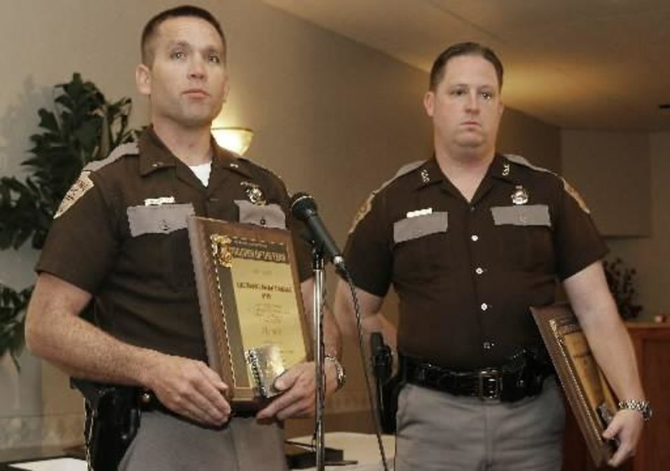 Trooper of the Year winners Lieutenant Brian Sturgill and  Trooper  Joe  Howard with their awards for a helicopter rescue during last year's flooding, Thursday, April 3, 2008. Photo by DAVID MCDANIEL, THE OKLAHOMAN