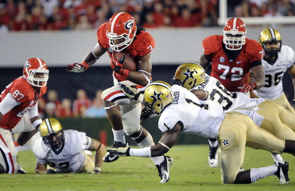 Photo -   Georgia running back Todd Gurley (3) rushes against Vanderbilt safety Kenny Ladler (1) and linebacker Chase Garnham (36) during the first half of an NCAA college football game on Saturday, Sept. 22, 2012, in Athens, Ga. (AP photo/John Amis)