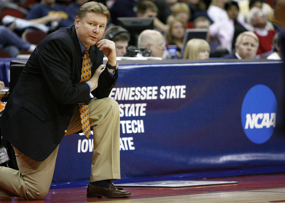 Photo - OSU coach Kurt Budke watches his team play during a first round game of the women's NCAA basketball tournament  between Oklahoma State University and East Tennessee State University at Wells Fargo Arena, Saturday, March 22, 2008, in Des Moines, Iowa.   BY BRYAN TERRY, THE OKLAHOMAN