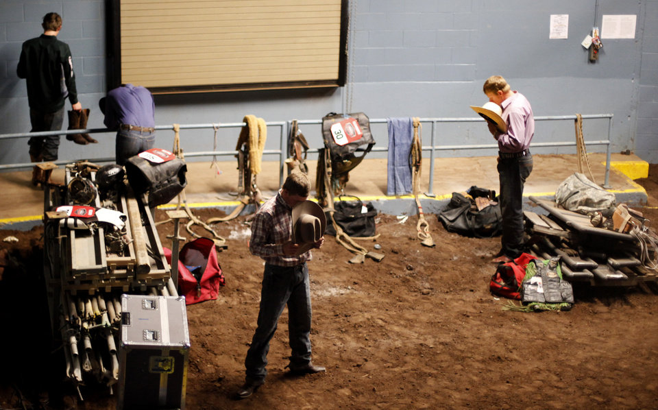 Contestants pray before the start of the National Circuit Finals Rodeo at State Fair Arena in Oklahoma City, Thursday, March 29, 2012. Photo by Bryan Terry, The Oklahoman