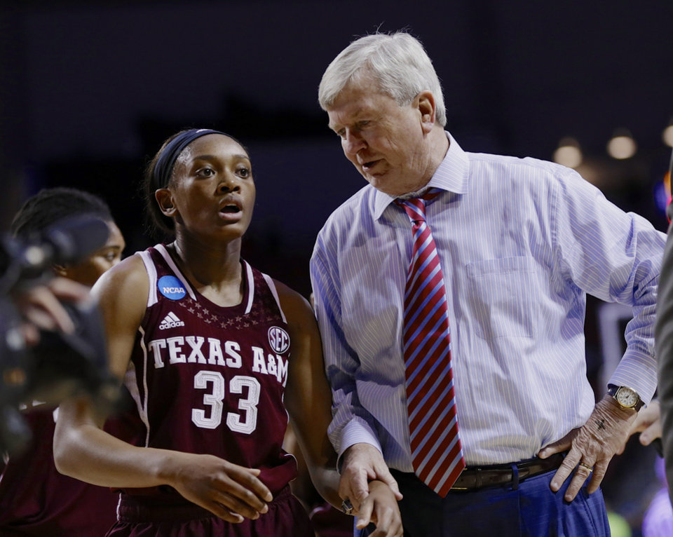 Photo - Texas A&M coach Gary Blair talks to Courtney Walker (33) at the end of the first half of a regional final game against Connecticut in the NCAA college basketball tournament in Lincoln, Neb., Monday, March 31, 2014. (AP Photo/Nati Harnik)