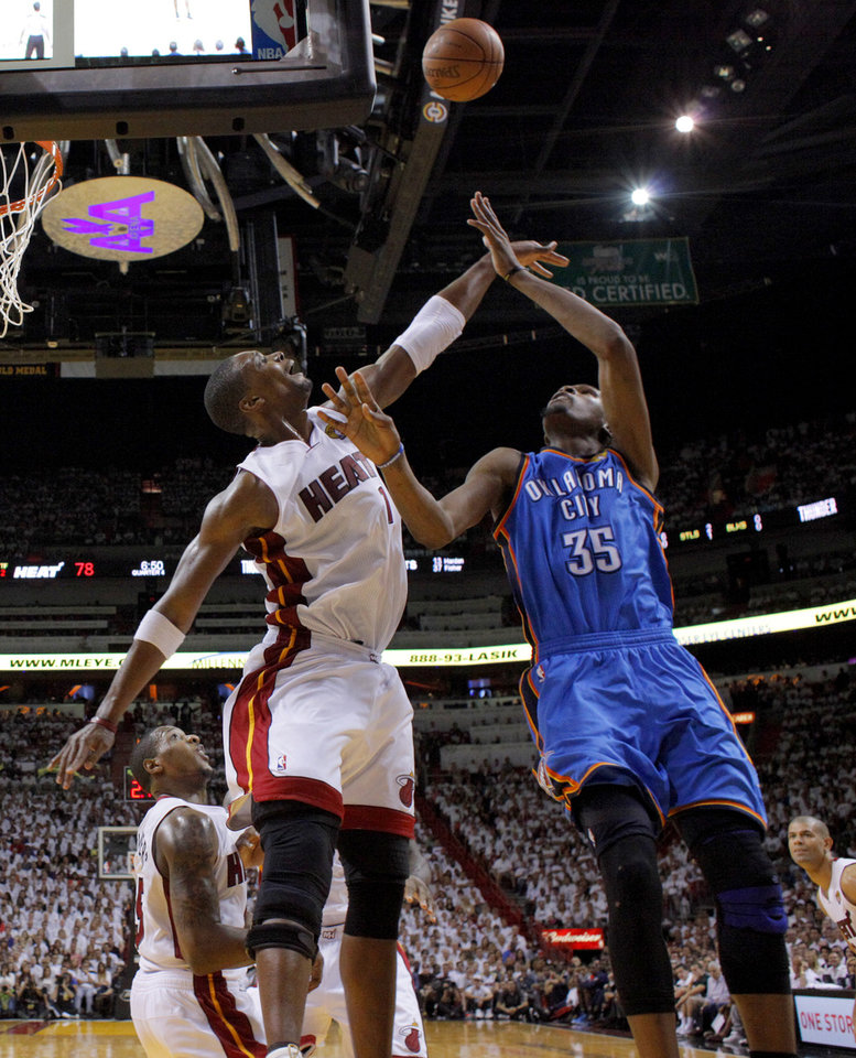 Photo - Oklahoma City's Russell Westbrook (0) can't get the ball over Miami's Chris Bosh (1) during Game 3 of the NBA Finals between the Oklahoma City Thunder and the Miami Heat at American Airlines Arena, Sunday, June 17, 2012. Oklahoma City lost 91-85. Photo by Bryan Terry, The Oklahoman