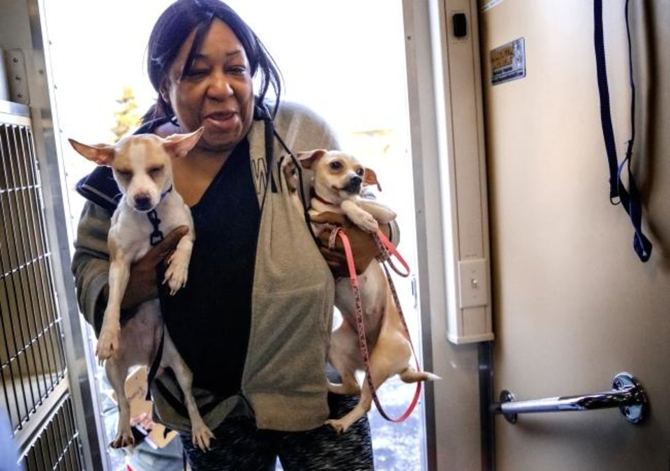 Photo -  Lynda Lewis takes her two dogs Nyla and Queenie into the Oklahoma Humane Society's mobile veterinary care unit as part of the Best Friends of Pets new