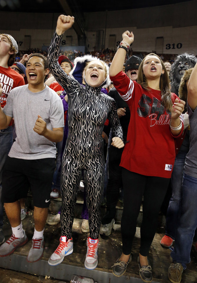 Sulphur fans Isaiah Simmons, Lindsey Lane and Devin Dunn shout during the 3A girls semifinal game between the Adair High School Lady Warriors and the Sulphur Lady Bulldogs at the State Fair Arena on Friday, March 8, 2013 in Oklahoma City, Okla. Photo by Steve Sisney, The Oklahoman