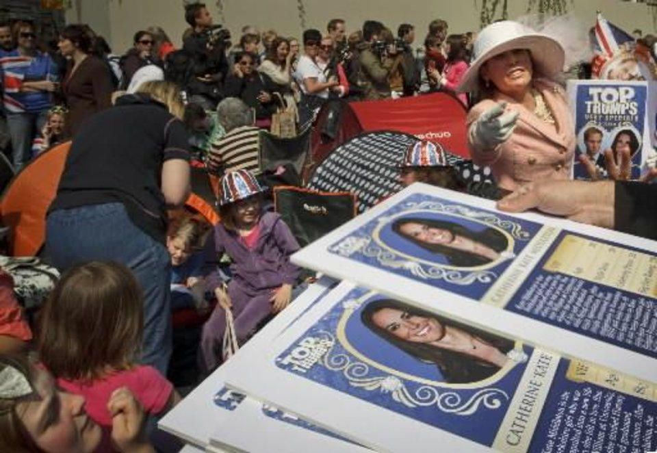 Photo - Royal enthusiasts sit in front of Westminster Abbey in London, Thursday, April 28, 2011. Revelers are camping outside the Abbey where Britain's Prince William and Kate Middleton are due to get married on Friday, April 29. (AP Photo/Daniel Ochoa de Olza)