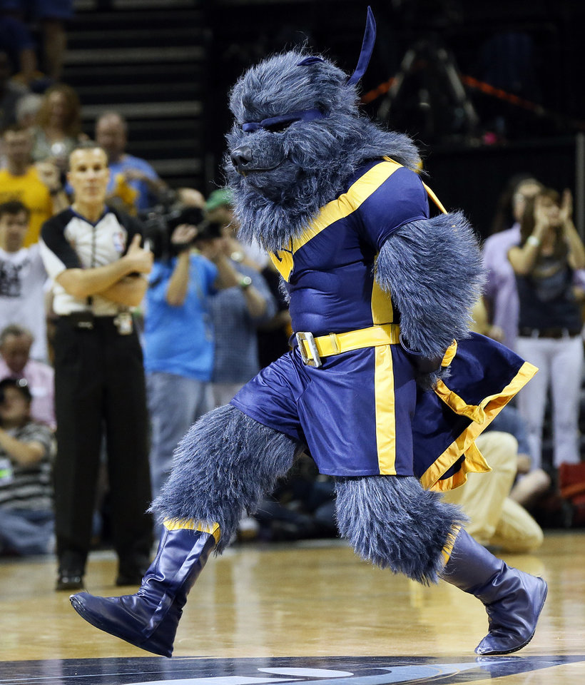 Photo - Memphis mascot Grizz works the crowd during Game 3 in the second round of the NBA basketball playoffs between the Oklahoma City Thunder and Memphis Grizzles at the FedExForum in Memphis, Tenn.,  Saturday, May 11, 2013. Memphis won, 87-81. Photo by Nate Billings, The Oklahoman