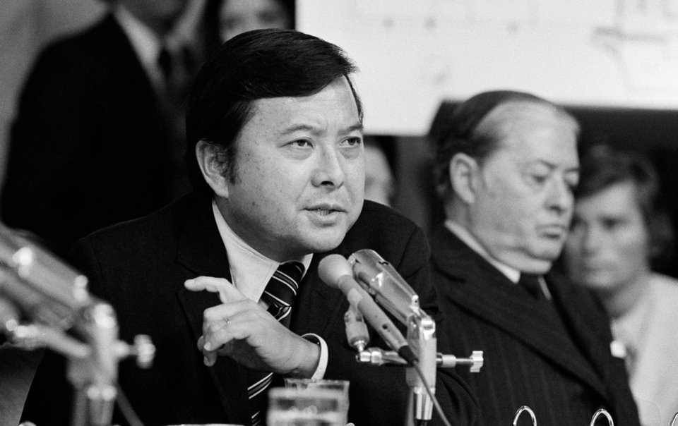 Photo - FILE - In this May 19, 1973 file photo, Sen. Daniel K. Inouye, D-Hawaii, a member of the Watergate investigating committee, questions witness James McCord during the hearing on Capitol Hill in Washington, as John M. Montoya, Democrat of New Mexico, is at right. Inouye, the influential Democrat who broke racial barriers on Capitol Hill and played key roles in congressional investigations of the Watergate and Iran-Contra scandals, died of respiratory complications, Monday, Dec. 17, 2012, according to his office. He was 88. (AP Photo/File)
