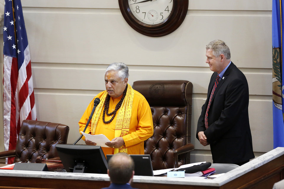 Photo -  Hindu statesman Rajan Zed delivers the invocation in Senate Chambers on Monday at the state Capitol as Sen. Gary Stanislawski, R-Tulsa, looks on. [Photo by Jim Beckel, The Oklahoman]