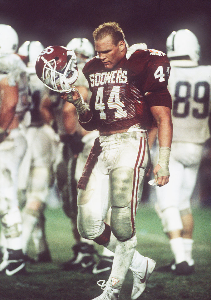 In this photo from the 1986 Orange Bowl, former Oklahoma linebacker Brian Bosworth walks off the field. Oklahoma beat Penn State 25-10. OKLAHOMAN ARCHIVE PHOTO