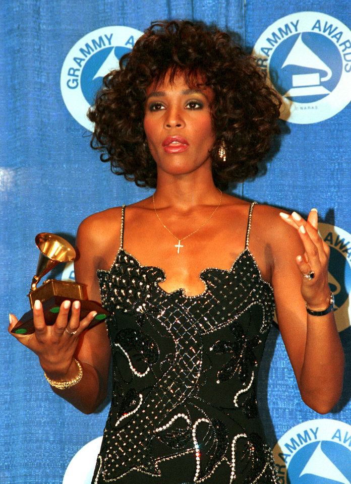 FILE - In this March 3, 1988, file photo, Whitney Houston poses with her Grammy at the annual Grammy Awards presentation in New York. Publicist Kristen Foster said, Saturday, Feb. 11, 2012, that singer Whitney Houston has died at age 48.    (AP Photo/Mark Lennihan, File) ORG XMIT: NY207