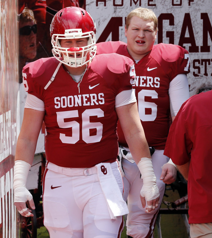 Photo - Ty Darlington (56) and Jake Reed (76) step onto the filed before the annual Spring Football Game at Gaylord Family-Oklahoma Memorial Stadium in Norman, Okla., on Saturday, April 13, 2013. Photo by Steve Sisney, The Oklahoman