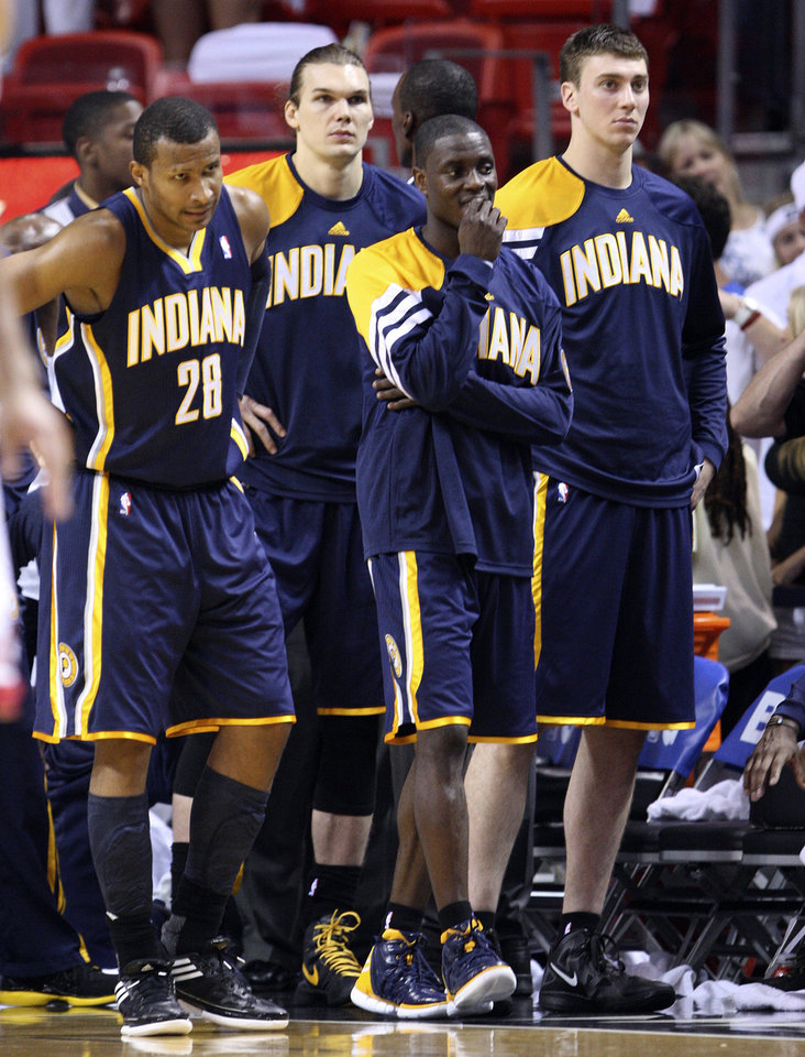 Photo -   From left, Indiana Pacers' Leandro Barbosa (28), Lou Amundson, Darren Collison and Tyler Hansbrough come off the bench as they watch the final seconds of the second half of Game 1 in an NBA basketball Eastern Conference semifinal playoff series against the Miami Heat, Sunday, April 13, 2012, in Miami. The Heat won 95-86. (AP Photo/Wilfredo Lee)