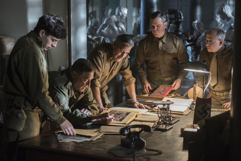 Photo - This image released by Columbia Pictures shows Dimitri Leonidas, John Goodman, George Clooney, Matt Damon and Bob Balaban in
