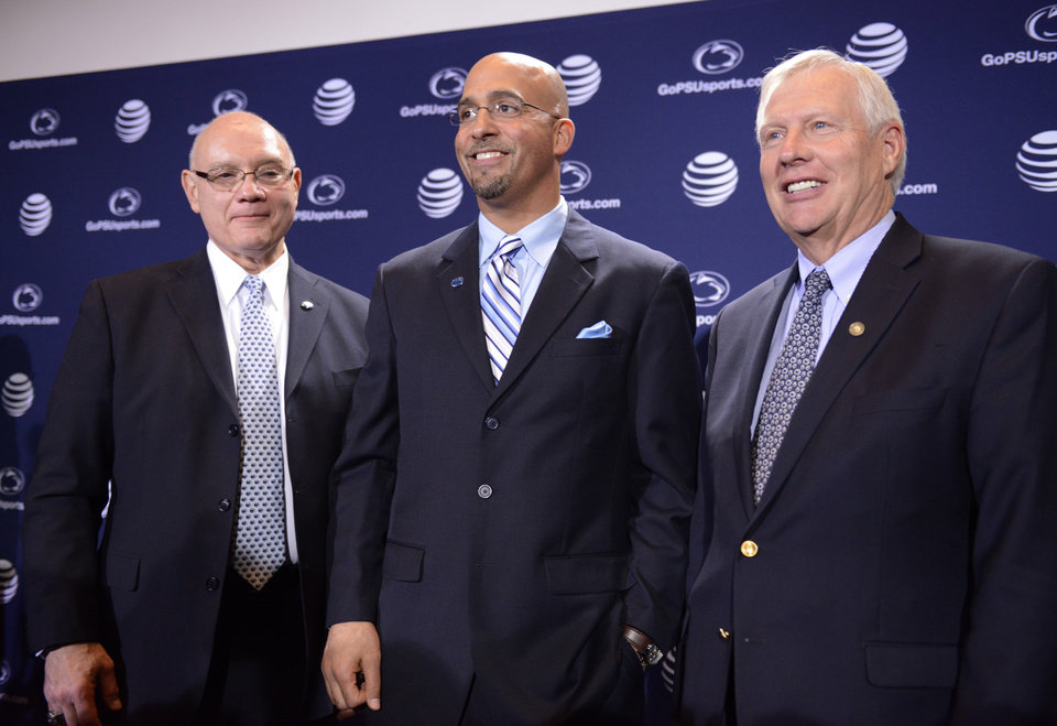 Photo - Penn State's new football coach James Franklin, center, poses with athletic director David Joyner, left. and Penn State president Rodney Erickson, right, after being introduced during an NCAA college football news conference on Saturday, Jan. 11, 2014, in State College, Pa. (AP Photo/John Beale)