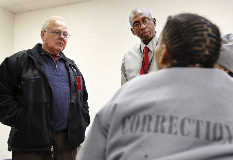 Photo - Oklahoma state Rep. Bobby Cleveland, District 20, left, talks to inmates during a recent visit to Mabel Bassett Correctional Center on Wednesday, Dec. 11, 2013. Accompanying Cleveland is a prison staff member. Photo by Jim Beckel, The Oklahoman