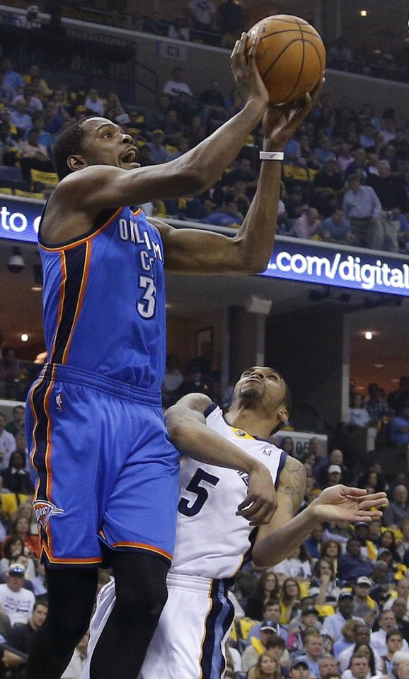 Photo - Oklahoma City's Kevin Durant (35) puts up a shot over Memphis' Courtney Lee (5) during Game 6  in the first round of the NBA playoffs between the Oklahoma City Thunder and the Memphis Grizzlies at FedExForum in Memphis, Tenn., Thursday, May 1, 2014. Photo by Bryan Terry, The Oklahoman