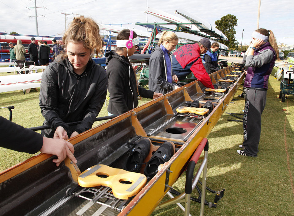 Photo - Rowers with the Kansas City Rowing Club prepare their rowing shell during the Oklahoma Regatta Festival on the Oklahoma River in Oklahoma City, OK, Saturday, October 5, 2013,  Photo by Paul Hellstern, The Oklahoman