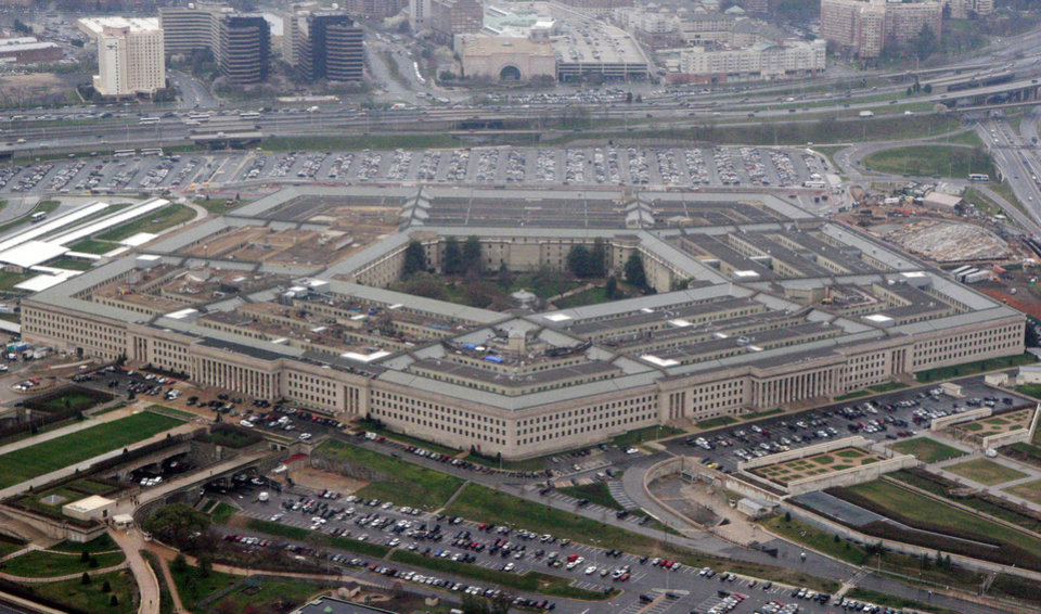 Photo -   FILE - In this March 27, 2008, file photo, the Pentagon is seen in this aerial view in Washington. Is the U.S. spending enough money on defense, and is it spending it in the right ways? In the aftermath of the 9/11 terrorist attacks the money spigot was turned wide open, pouring hundreds of billions of dollars into the wars in Iraq and Afghanistan and expanding the armed forces. Now that's changing, and an important issue in the election is whether budget cuts have gone too far. (AP Photo/Charles Dharapak, File)