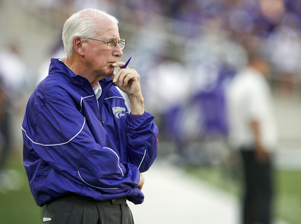 Kansas State Head Coach Bill Snyder studies the North Dakota State Buffalos prior to the opening kick off of Fan NCAA college football  game in Manhattan, Kan.,  Friday, Aug. 30, 2013.  North Dakota State upset Kansas State 24-21.  (AP Photo/The Topeka Capital Journal, Chris Neal)