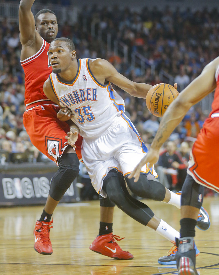 Photo - Oklahoma City Thunder's Kevin Durant (35) heads to the basket against the Chicago Bulls in the second quarter during their  preseason NBA basketball game in Wichita, Kan., Wednesday, Oct. 23, 2013. (AP Photo/The Wichita Eagle, Fernando Salazar) LOCAL TV OUT; MAGAZINES OUT; LOCAL RADIO OUT; LOCAL INTERNET OUT