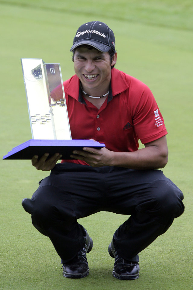 Photo - Andres Romero of Argentina shows the trophy after winning the the Deutsche Bank Players' Championship Golf Tournament at Gut Kaden in Alveslohe, near Hamburg, northern Germany, on Sunday, July 29, 2007. He ended with a par of -19 and recieves a price money of 600.000 Euros (818,218 USD). (AP Photo/Kai-Uwe Knoth) ORG XMIT: KGOL124