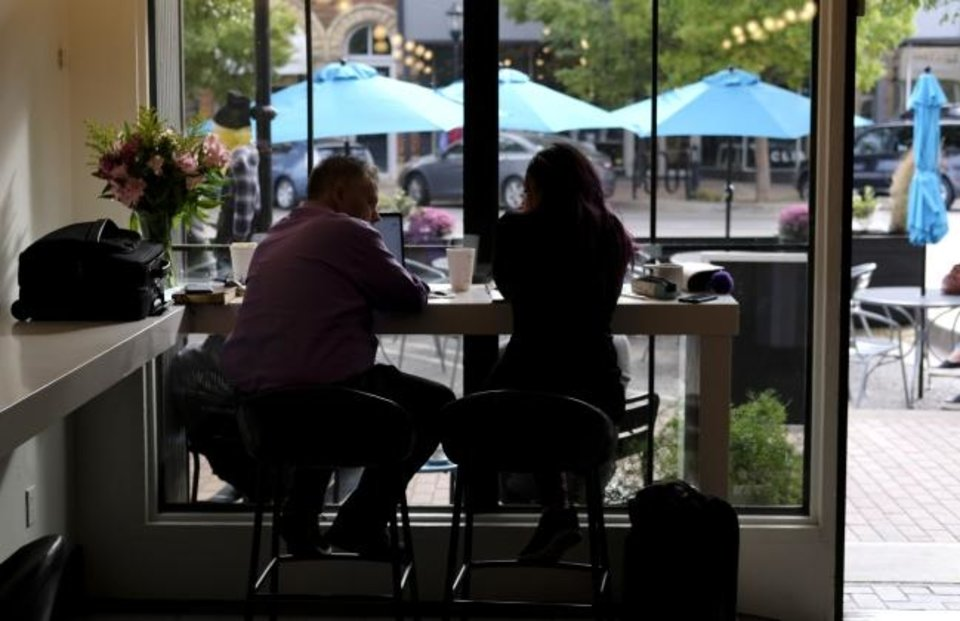 Photo - Cafe Evoke. Streateries in downtown Edmond. Restaurants/cafes were allowed  to take over street space to expand their dining options during the pandemic. Thursday, October 15, 2020. [Doug Hoke/The Oklahoman]