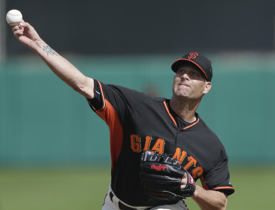 CORRECTS TO SCOTTSDALE NOT PHOENIX - San Francisco Giants starting pitcher Tim Hudson throws against the Arizona Diamondbacks during the first inning of a spring exhibition baseball game on Sunday, March 2, 2014, in Scottsdale, Ariz. (AP Photo/Gregory Bull)