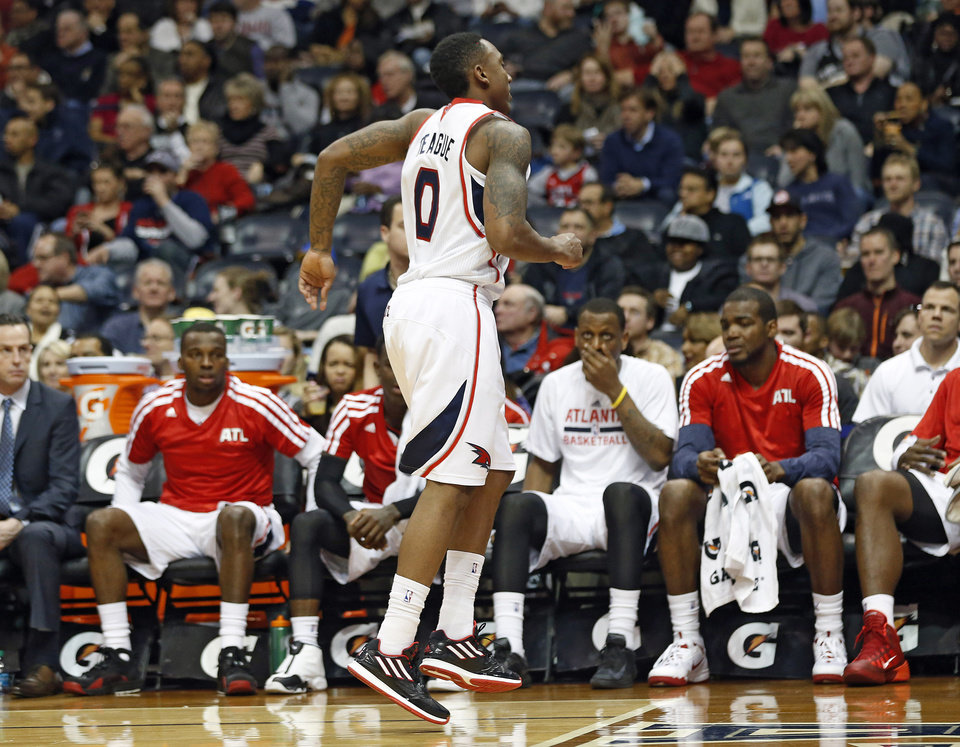 Photo - Atlanta Hawks point guard Jeff Teague (0) limps off the court after being injured in the first half of an NBA basketball game against the San Antonio Spurs Friday, Jan. 24, 2014, in Atlanta.  (AP Photo/John Bazemore)