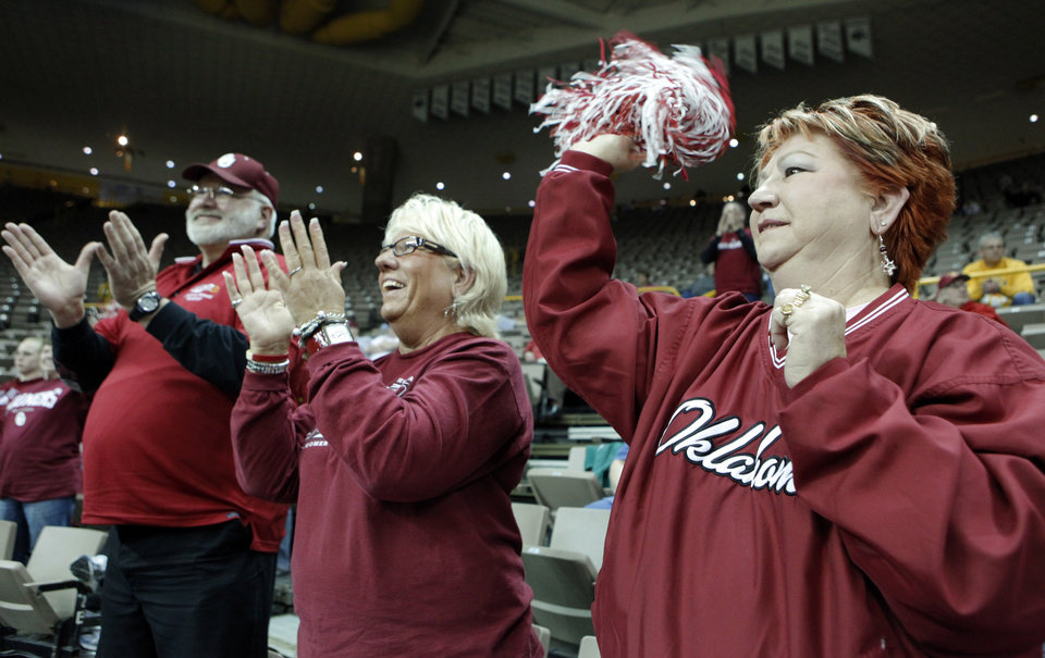 Photo - Oklahoma City fans Tom Zweiacher, Sarah Jarel, and Carol Funk celebrate as the University of Oklahoma (OU) defeats Georgia Tech 69-50 in round two of the 2009 NCAA Division I Women's Basketball Tournament at Carver-Hawkeye Arena at the University of Iowa in Iowa City, IA on Tuesday, March 24, 2009. 