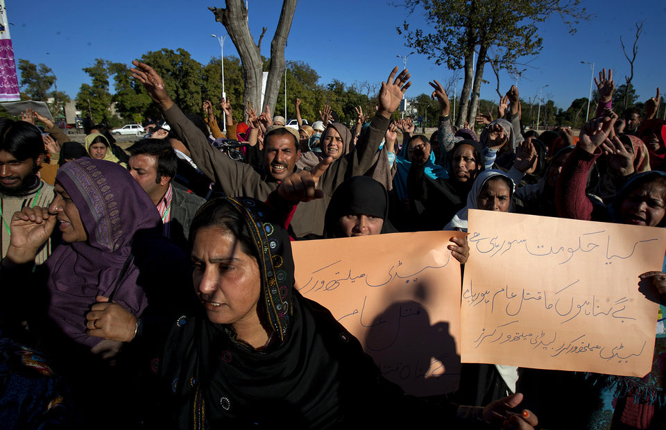 Pakistani polio workers chant slogans during a demonstration against the killing of their colleagues, Wednesday, Dec. 19, 2012 in Islamabad, Pakistan. Gunmen shot dead a woman working on U.N.-backed polio vaccination efforts and her driver in northwestern Pakistan, officials said, just a day after similar attacks across the country killed five female polio workers. The placard on right reads,