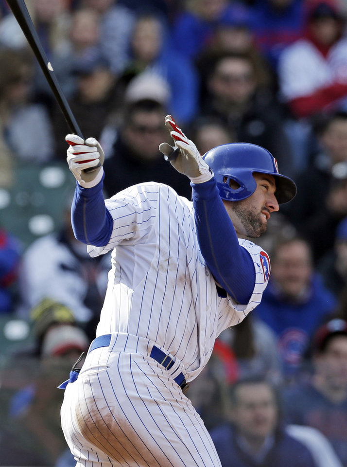 Photo - Chicago Cubs' Ryan Kalish hits a two-run double during the sixth inning of a baseball game against the Philadelphia Phillies in Chicago, Sunday, April 6, 2014. (AP Photo/Nam Y. Huh)