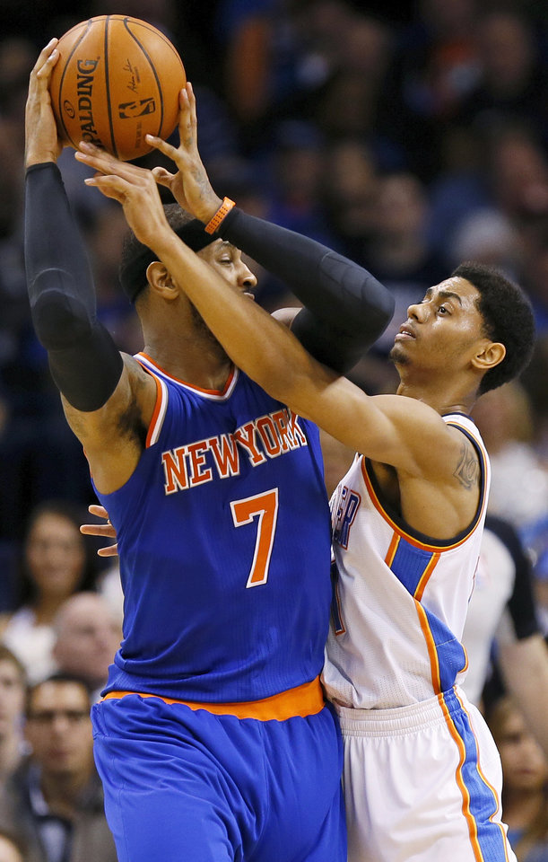Photo - Oklahoma City's Jeremy Lamb (11) defends New York's Carmelo Anthony (7) during an NBA basketball game between the New York Knicks and the Oklahoma City Thunder at Chesapeake Energy Arena in Oklahoma City, Sunday, Feb. 9, 2014. Photo by Nate Billings, The Oklahoman