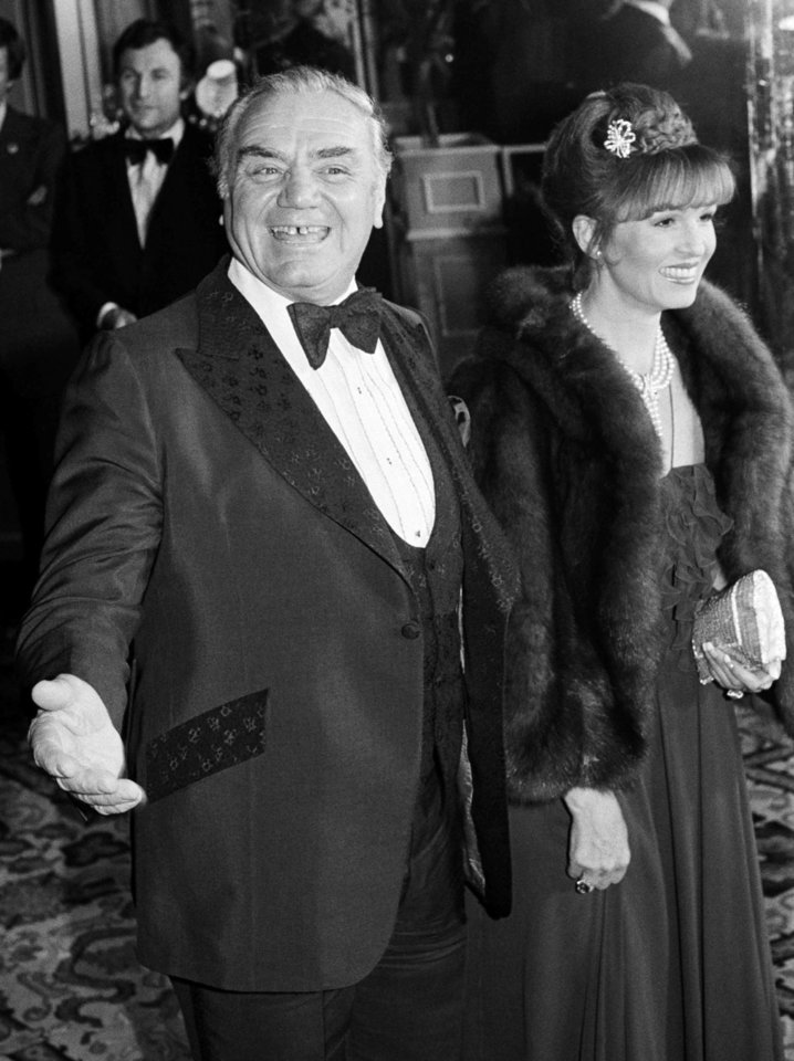 Photo -   FILE - In this Feb. 29, 1980, file photo, actor Ernest Borgnine arrives with his wife, Tova, at the American Film Institute's salute to actor Jimmy Stewart in Beverly Hills, Calif. A spokesman said Sunday, July 8, 2012, that Borgnine has died at the age of 95. (AP Photo/ Lennox McLendon, File)