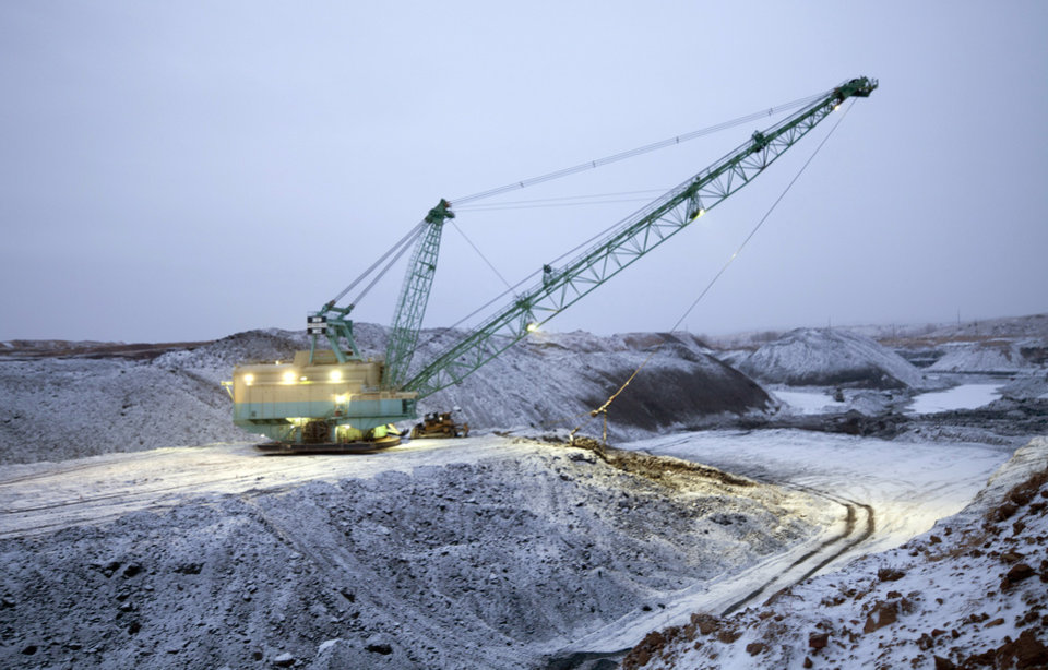 Photo - FILE - In this undated file photo provided by Ambre Energy, a dragline moves earth at the Decker Coal Mine in Decker, Mont. Coal companies announced an agreement Thursday, Sept. 4, 2014 to consolidate ownership of Montana's Decker coal mine. The deal between Wyoming-based Cloud Peak Energy and Ambre Energy of Australia is aimed at boosting exports of the fuel to Asia through ports on the U.S. West Coast. (AP Photo/Ambre Energy, Laszlo Bencze, File)