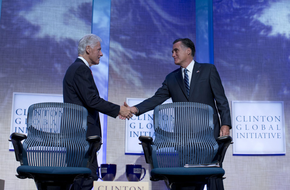 Photo -   Former President Bill Clinton shakes hands with Republican presidential candidate, former Massachusetts Gov. Mitt Romney after he spoke at the Clinton Global Initiative convention in New York, Tuesday, Sept. 25, 2012. (AP Photo/ Evan Vucci)